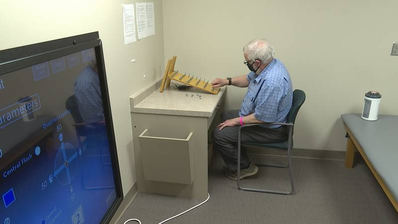 Alan Perry is working hard to improve mobility in his right hand after having a stroke in March.