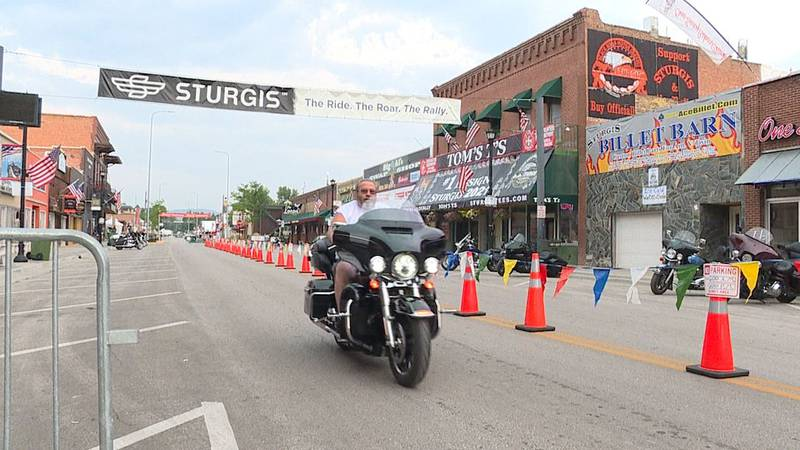 A motorcyclist rides onto Main Street Sturgis as visitors begin trickling in for the first day...