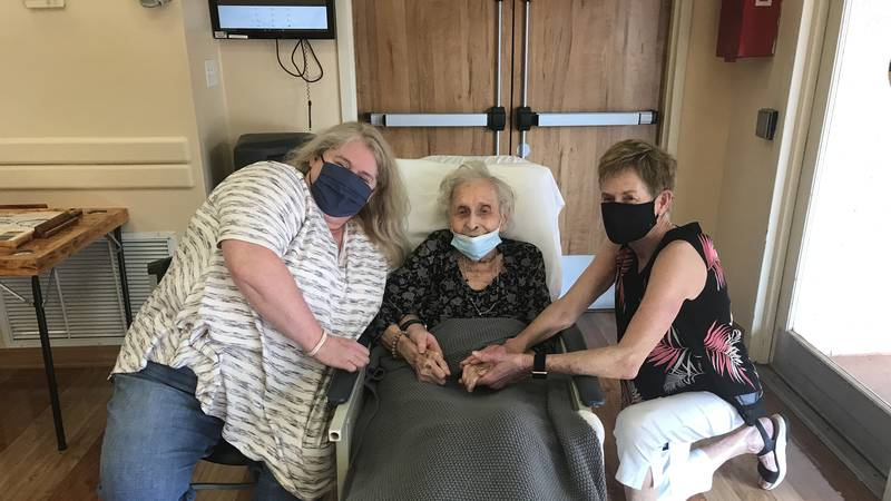 Laura Jerstad (middle) shares a special moment with her granddaughter, Rachel Jerstad (left),...