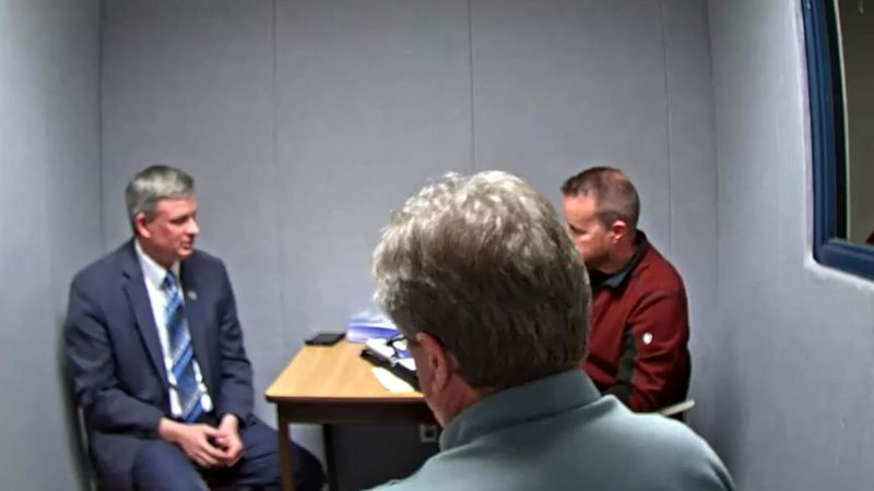South Dakota Attorney General Jason Ravnsborg (left) is interviewed by law enforcement...