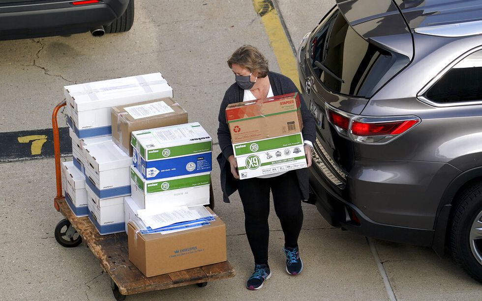 Election officials from around Dane County bring ballots in, Thursday, Nov., 19, 2020 to the...