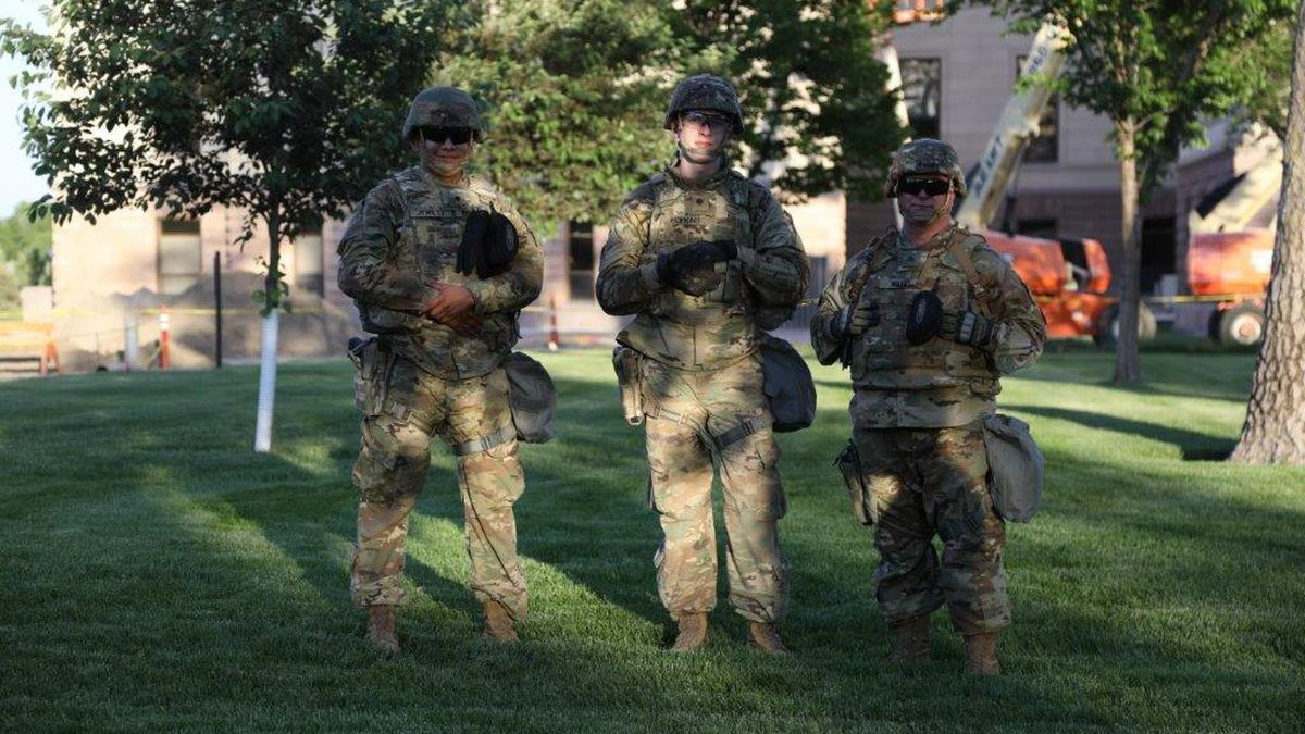 Soldiers of the 235th Military Police, SDNG patrol the grounds of the State Capitol in Pierre Monday evening.  Similar units were observed Tuesday night but in lesser numbers. (SDBA photo)