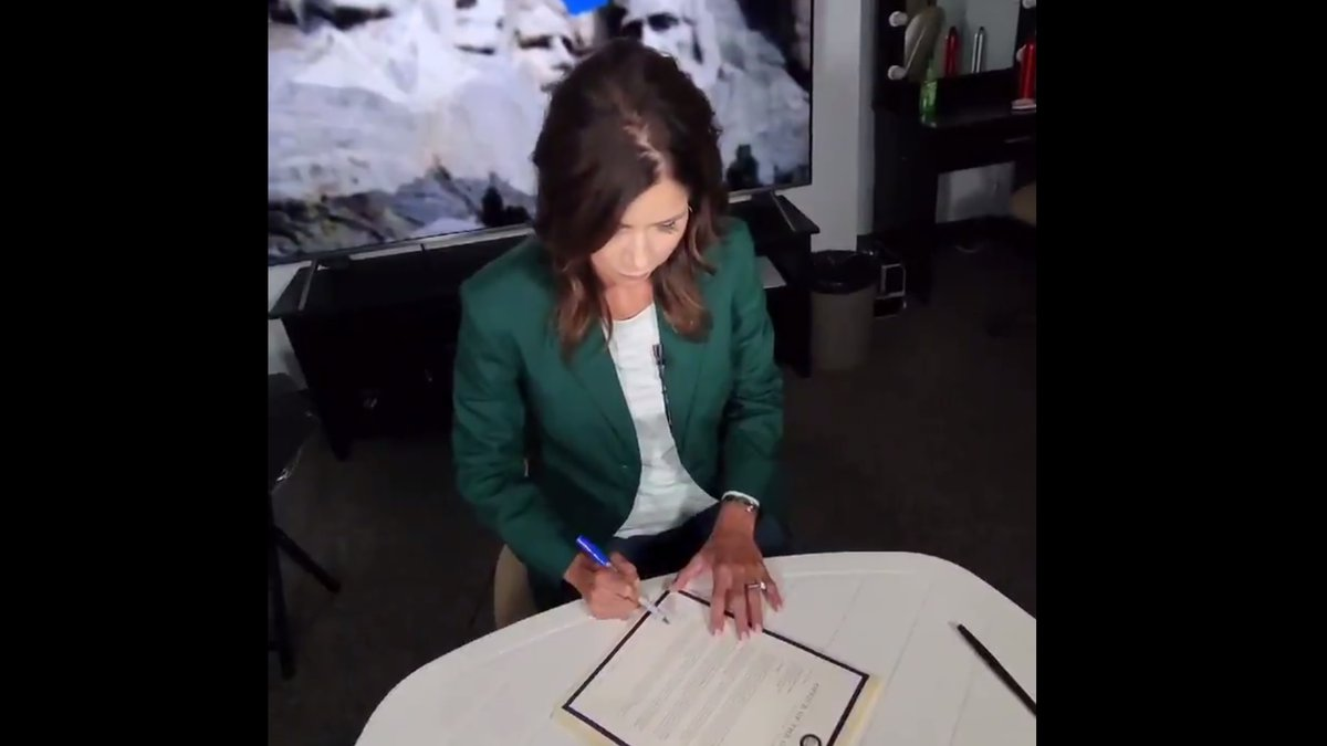 Gov. Kristi Noem (R, S.D.) signs a letter to President Biden resubmitting a request to allow an...