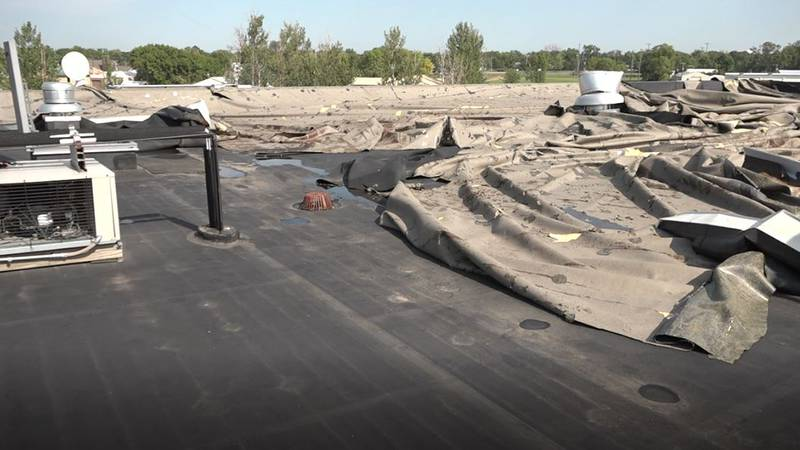 Lennox High School roof damaged in Saturday's storm.