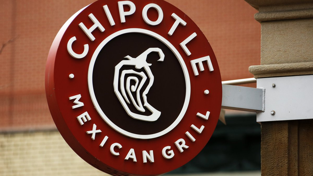 FILE - In this Jan. 12, 2017, file photo, a Chipotle restaurant sign hangs in Pittsburgh....