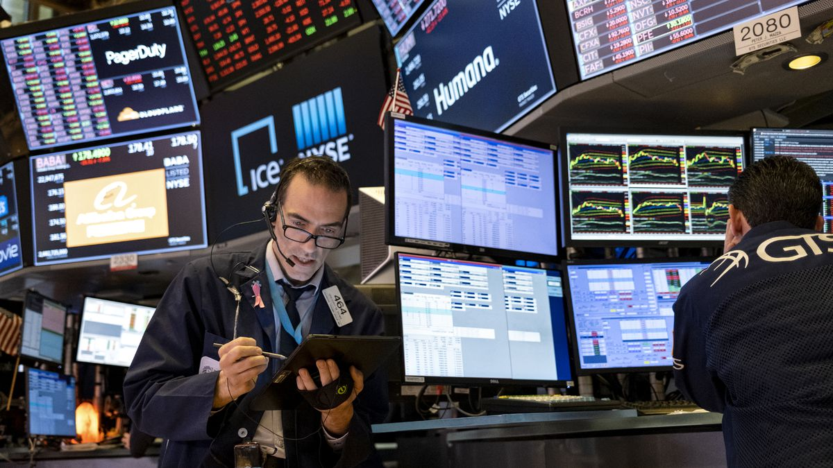 FILE - In this March 16, 2020 file photo, trader Gregory Rowe works on the floor of the New...
