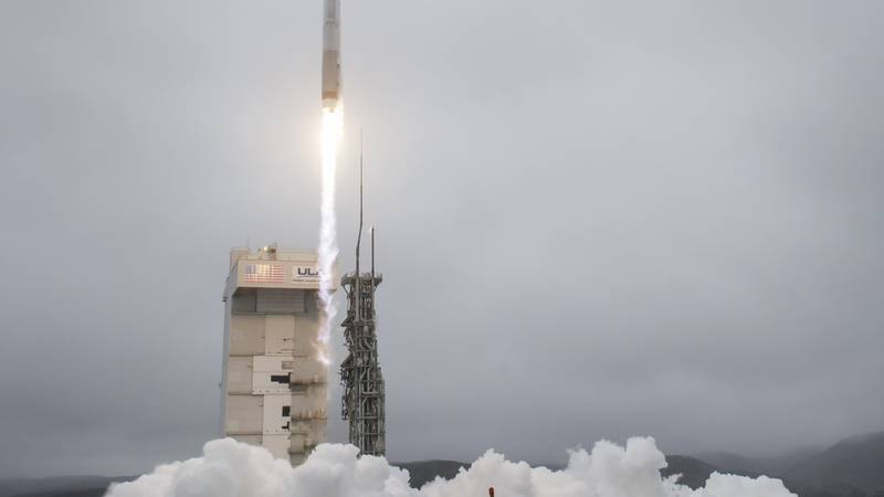 A United Launch Alliance Atlas V rocket carrying the Landsat 9 satellite onboard launches from...