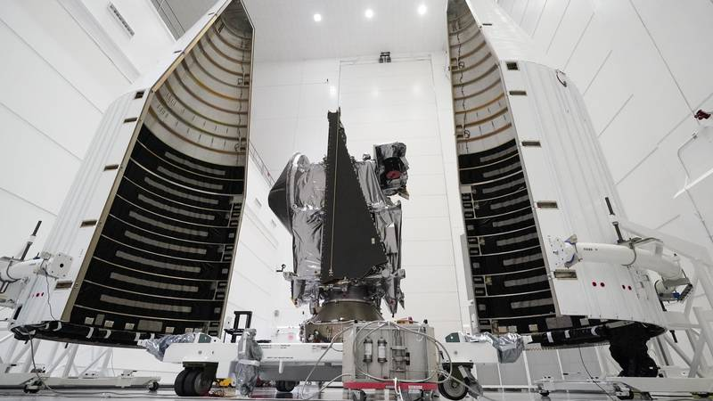 This Wednesday, Sept. 29, 2021 file photo shows NASA's Lucy spacecraft with its housing at the...