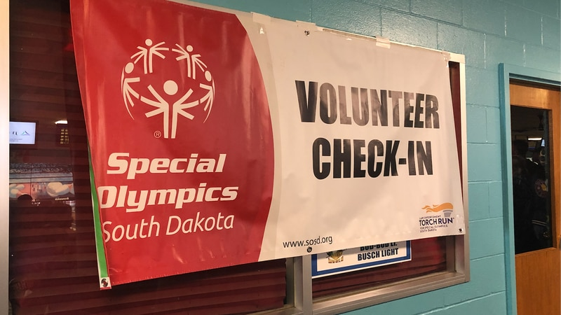 Volunteer check-in for South Dakota Special Olympics bowling.