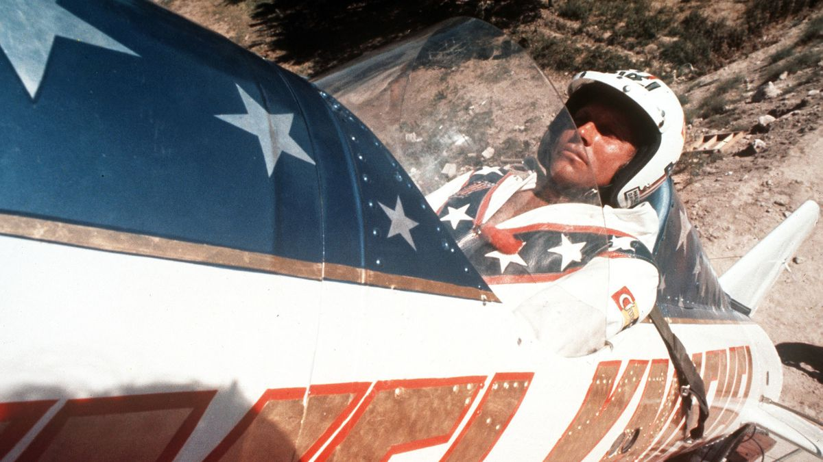"""FILE - In this Sept. 8, 1974, file photo, Evel Knievel sits in the steam-powered rocket motorcycle that will hopefully take him across Snake River Canyon in Twin Falls, Idaho. Evel Knievel's son is on a collision course with the Walt Disney Co. and Pixar over a movie daredevil character named Duke Caboom. A federal trademark infringement lawsuit filed Tuesday, Sept. 22, 2020, in Las Vegas accuses the moviemaker of improperly basing the """"Toy Story 4"""" character on Knievel."""