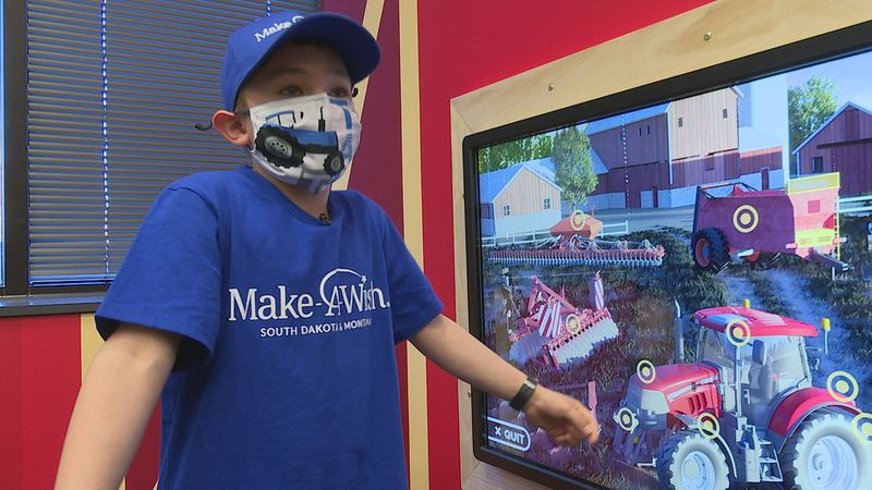 Koen's wish day reveals his year-long design; an interactive farm-themed waiting room for the...