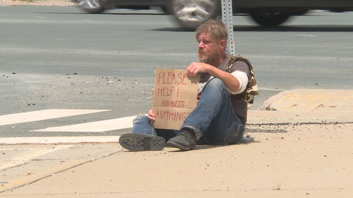 Steven panhandles for money and food at East 10th and I-229 in Sioux Falls