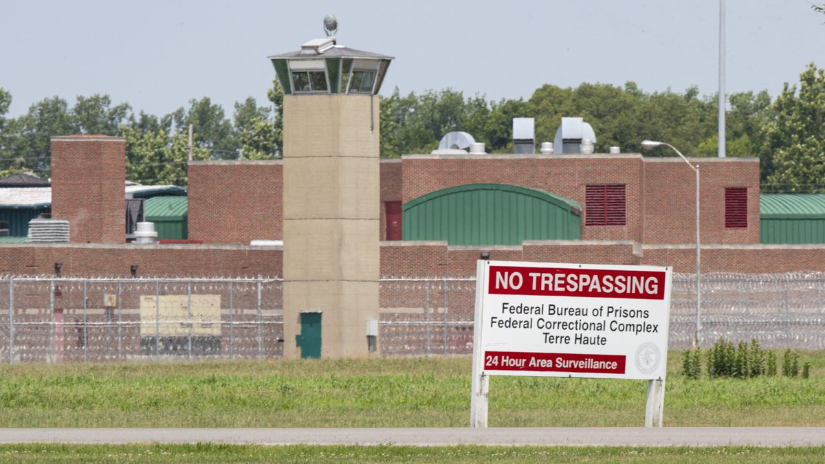 This July 15, 2020, file photo shows the entrance to the federal prison in Terre Haute, Ind. A...