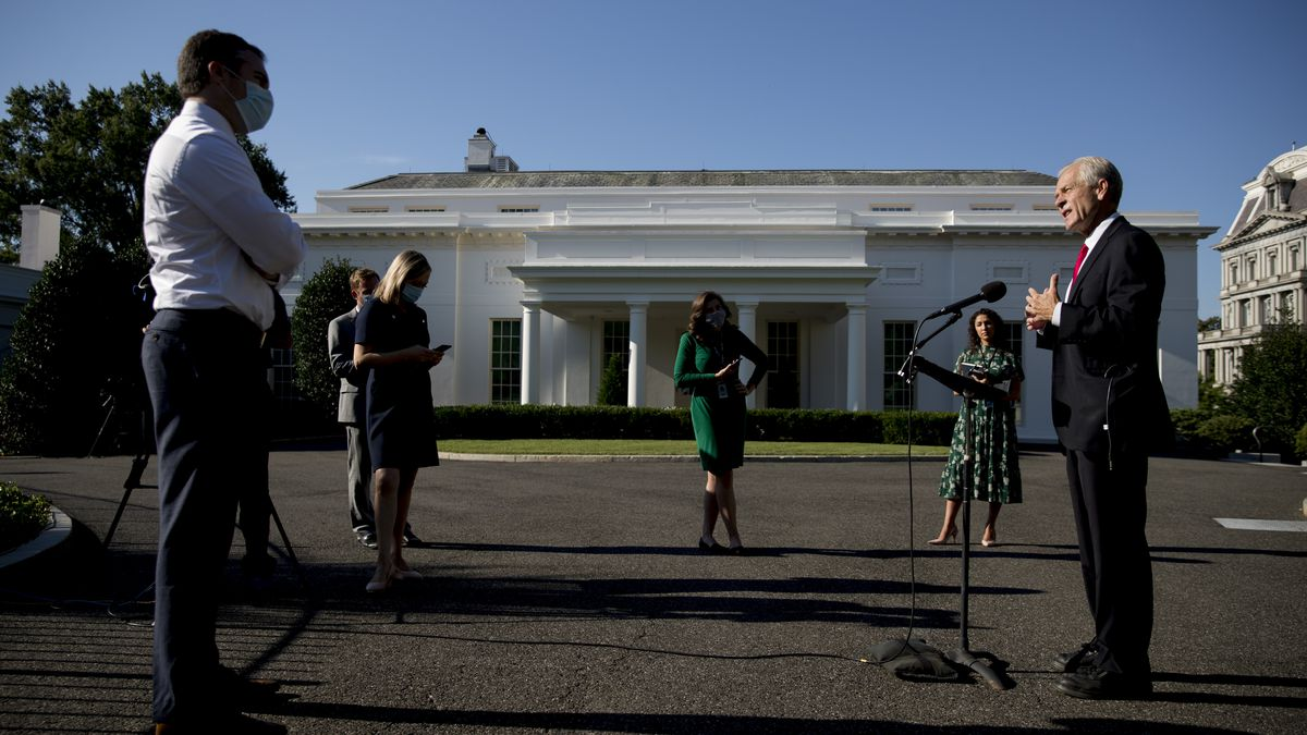 White House trade adviser Peter Navarro speaks with reporters outside the West Wing at the...