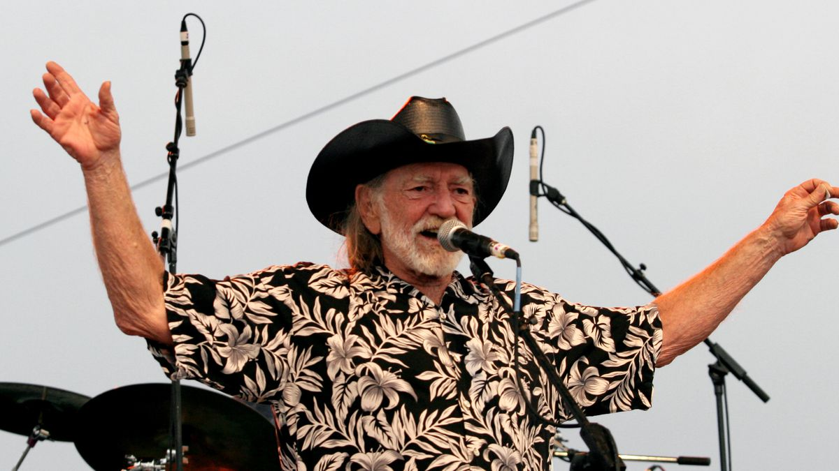 FILE - In this July 4, 2006, file photo, Willie Nelson addresses fans attending his Fourth of July Picnic in Ft. Worth, Texas. Willie Nelson's annual Fourth of July Picnic is going ahead this year, but to reduce concerns about the coronavirus the event will be virtual. Fans can tune in to the nearly 50-year-old music bash Saturday via livestream. (AP Photo/Rex C. Curry, File)