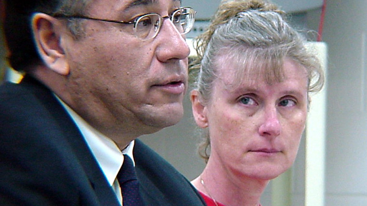 Debra Jenner-Tyler, right, looks at her attorney, Ron Volesky, Tuesday, April 19, 2005, at...