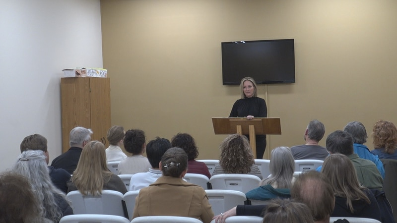 Christine Erickson talking at the 'Unmask the Truth of Siouxland' Meeting.