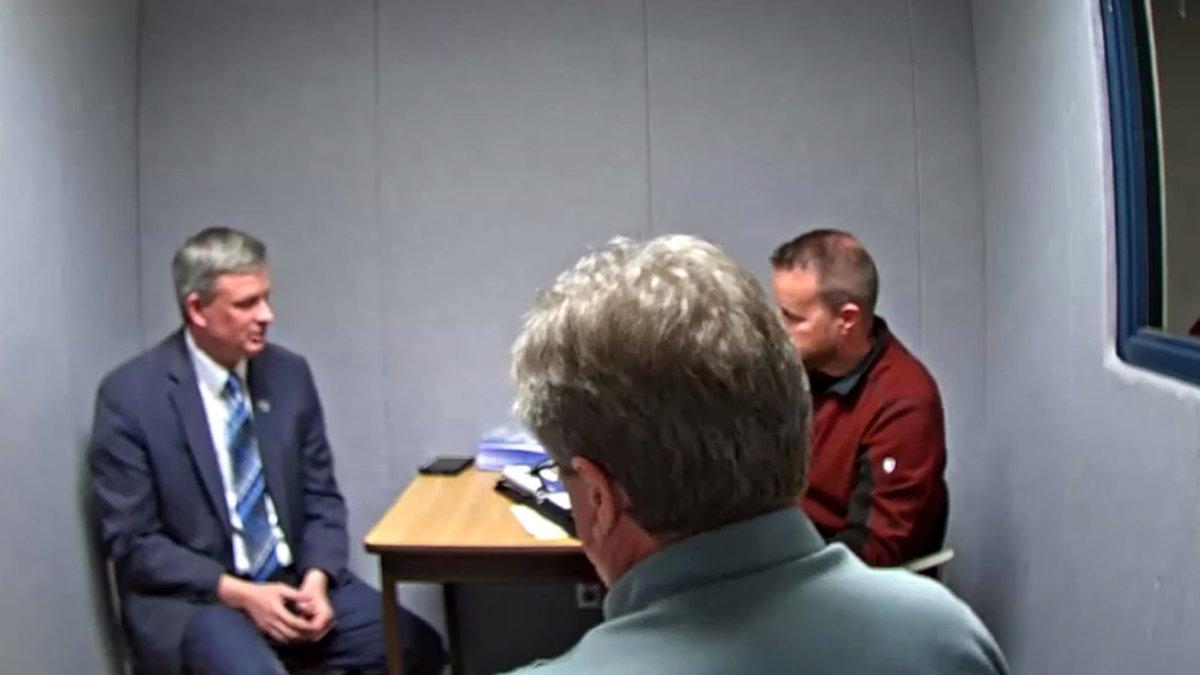 South Dakota Attorney General Jason Ravnsborg (left) is interviewed by law enforcement...