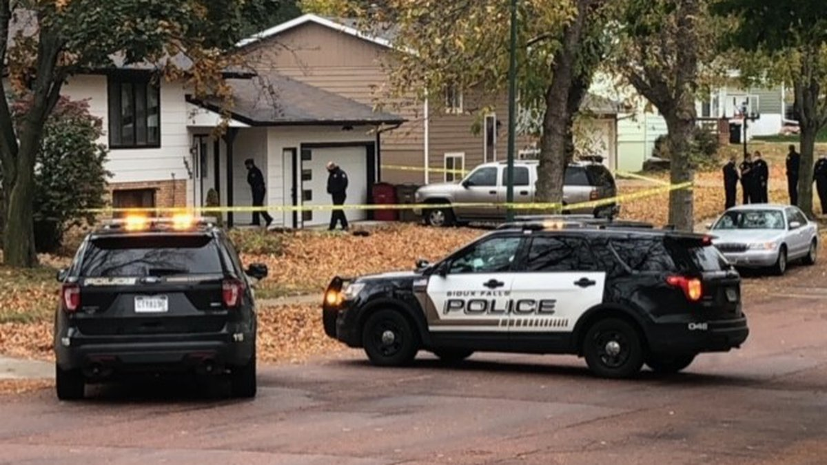 Police respond to a shooting at a Sioux Falls home Wednesday.