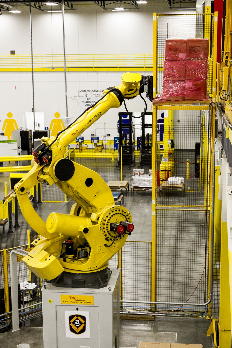 Employees at Amazon's Sioux Falls Fulfillment Center will work alongside robotics to pick, pack...