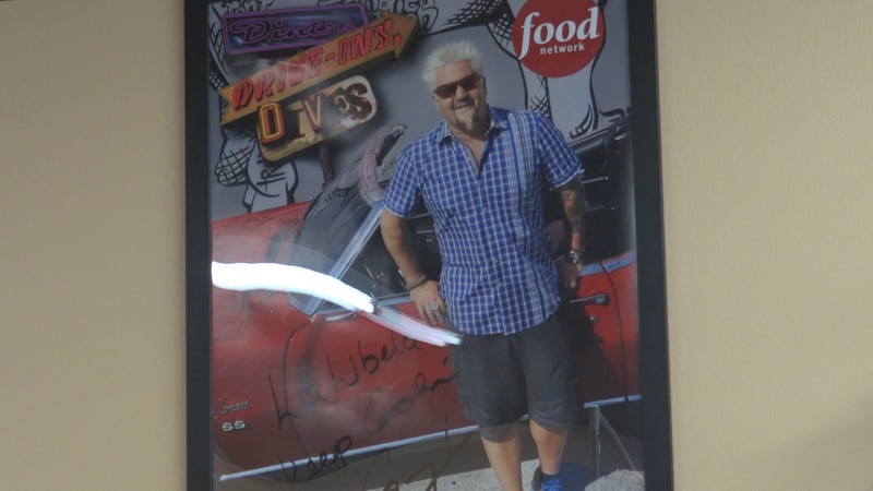 Poster of Guy Fieri inside diner featured in his shop