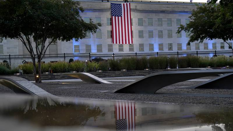 An American flag is unfurled at the Pentagon in Washington, Saturday, Sept. 11, 2021, at...