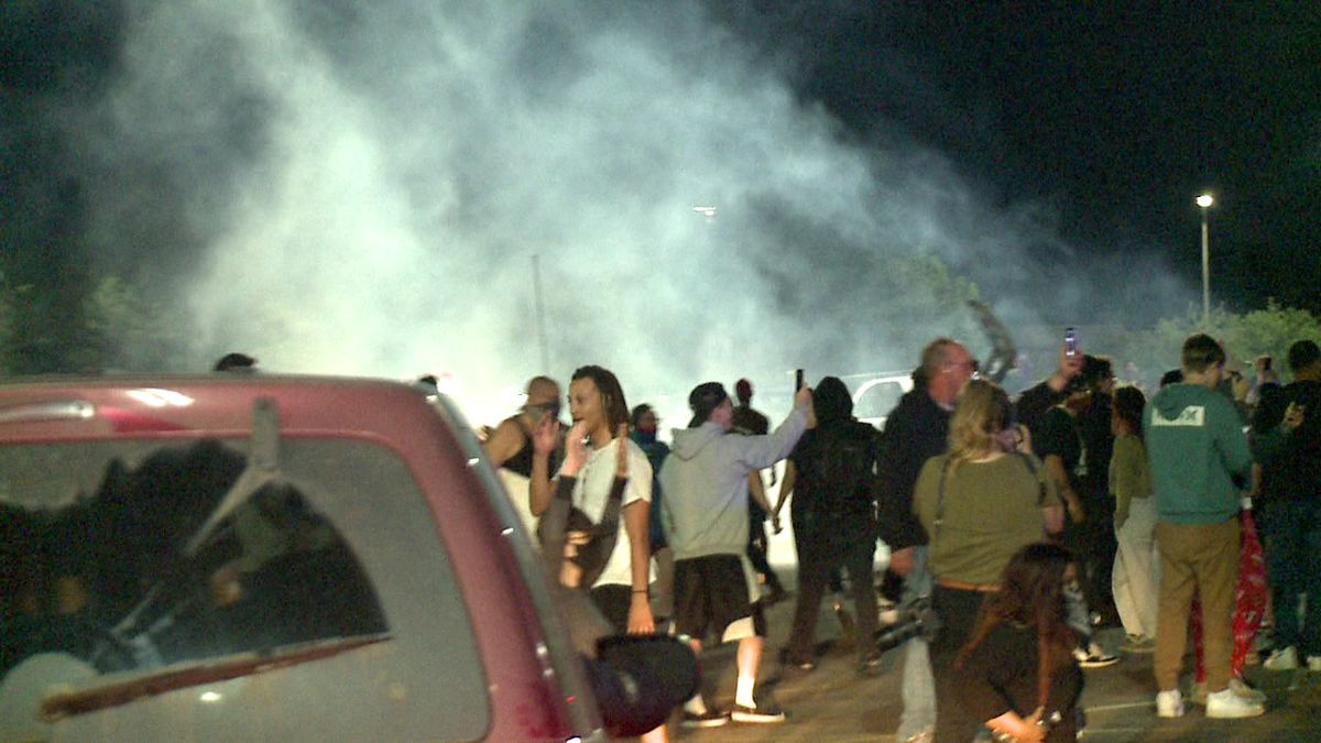 A haze of what appears to be tear gas hovers over protests that broke out outside the Empire Mall in Sioux Falls Sunday night.