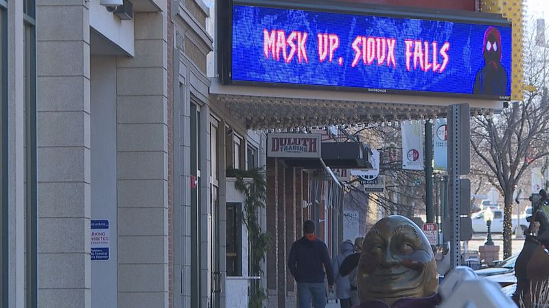 Health officials are calling for people to continue to wear masks into the holiday season, as...