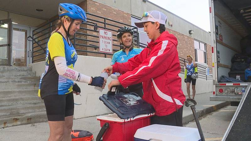 13-year-old Lanford DeKam hands out beverages to RASDak riders in Platte before they take off...