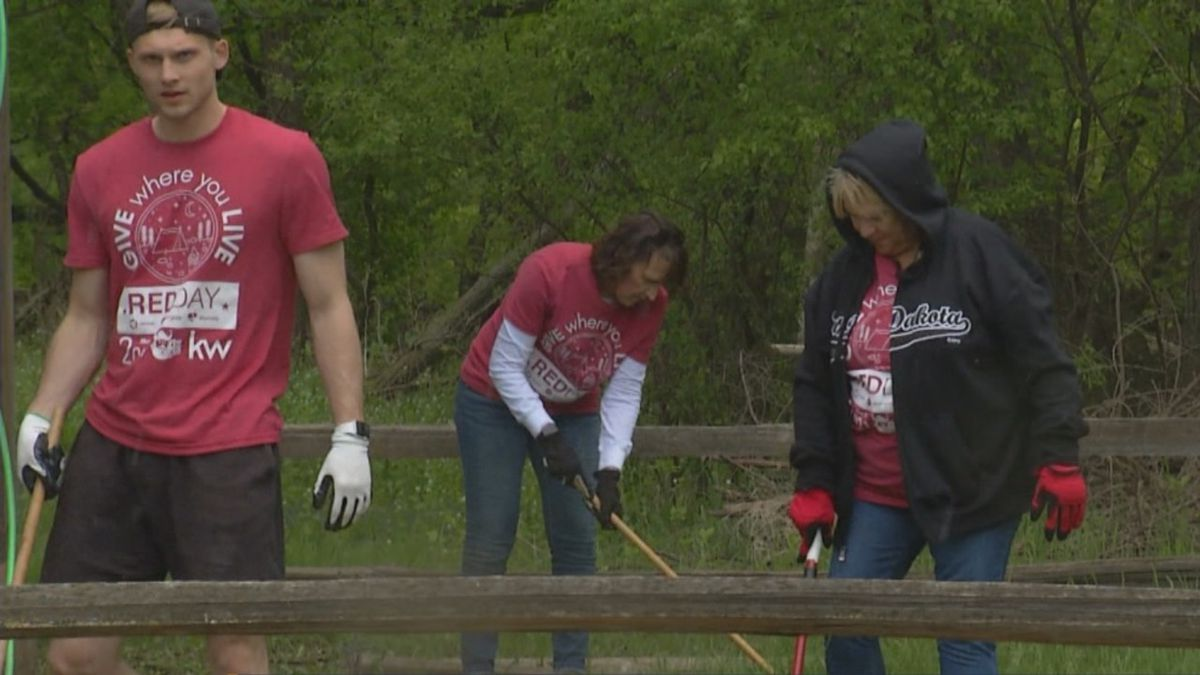 """The team from Keller Williams Realty was at the camp for their annual """"Red Day"""" of volunteering."""
