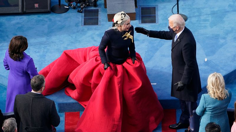 President-elect Joe Biden greets Lady Gaga during the 59th Presidential Inauguration at the...