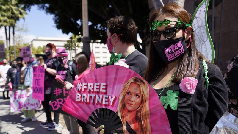 FILE - Britney Spears supporter Kiki Norberto holds a hand fan outside a court hearing...