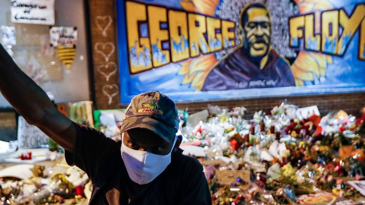 Protesters gather at a memorial for George Floyd where he died outside Cup Foods on East 38th...