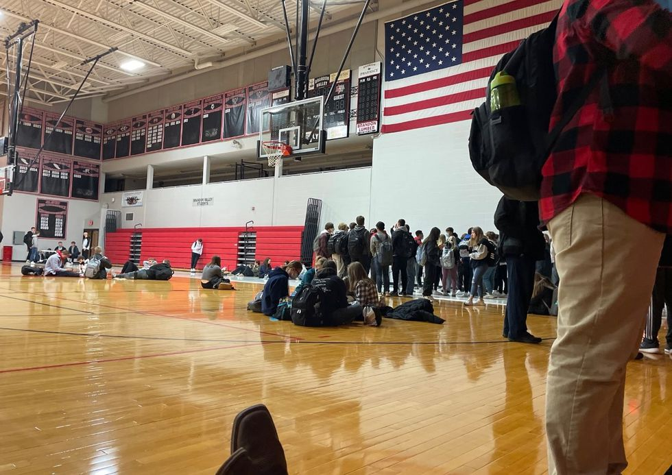 Students gather in the gym after power was partially restored at Brandon Valley High School.