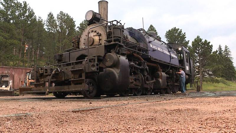A crew member works to prepare the 1880 Train for a day of rides in the Black Hills.