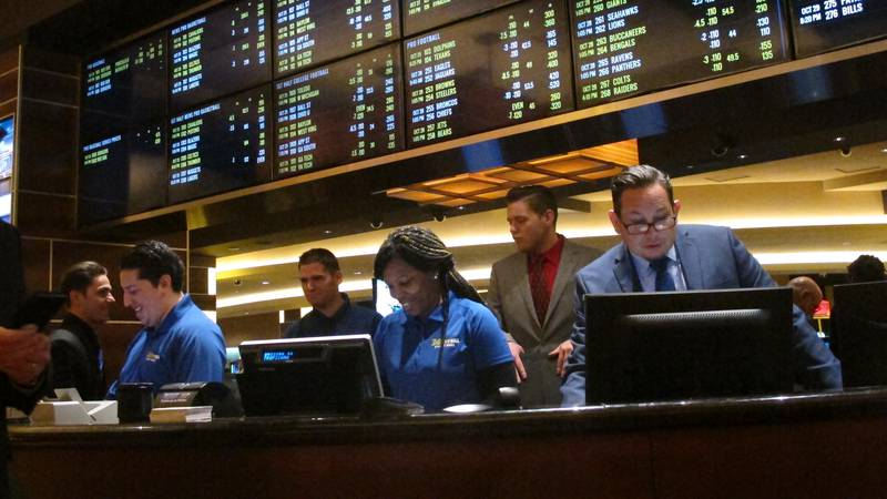 This Oct. 25, 2018 photo shows employees at the new sports book at the Tropicana casino in...
