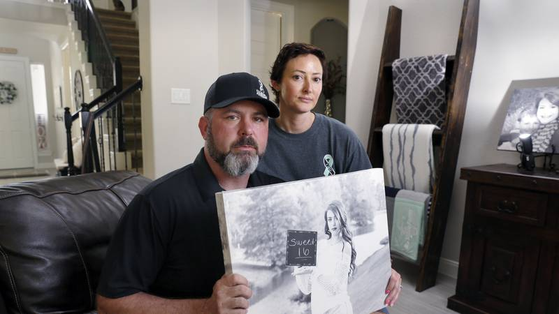 In this Oct. 12, 2021, photo, David and Wendy Mills, parents of Kailee Mills who was killed...