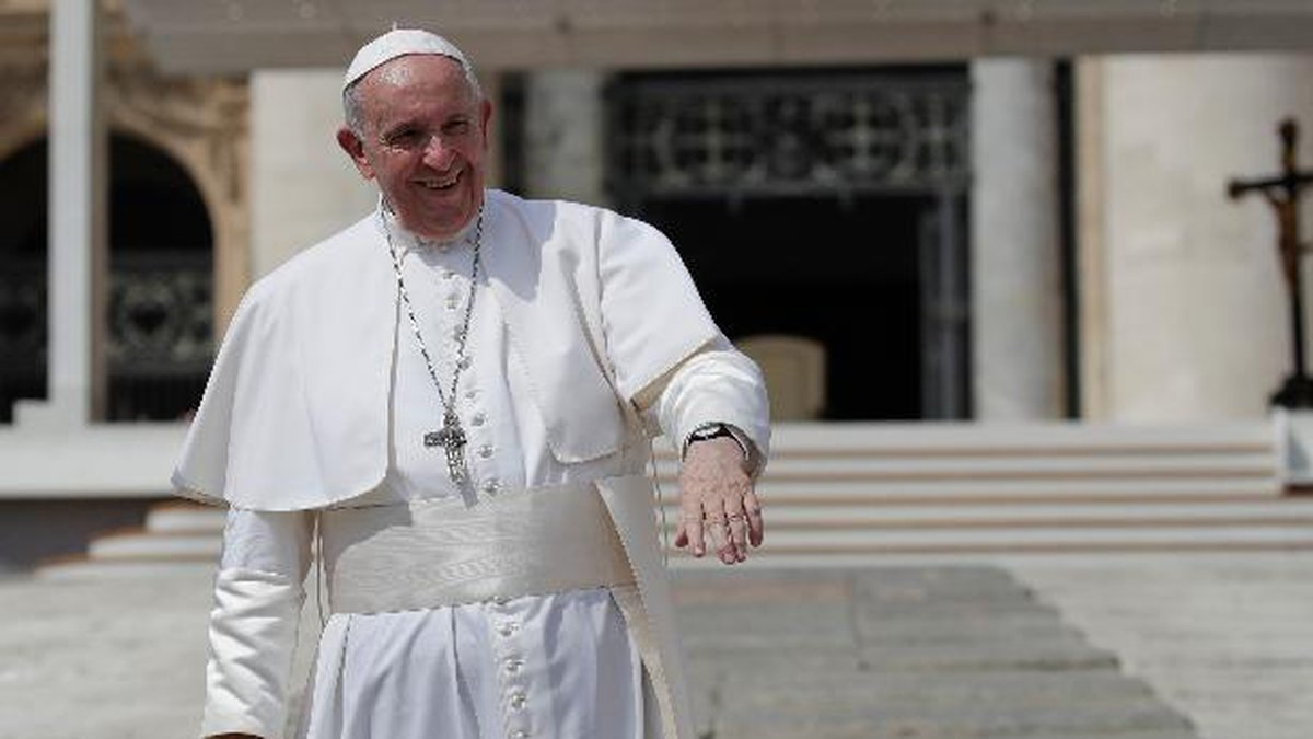 Pope Francis salutes pilgrims and faithful as he leaves St. Peter's Square at the Vatican after...
