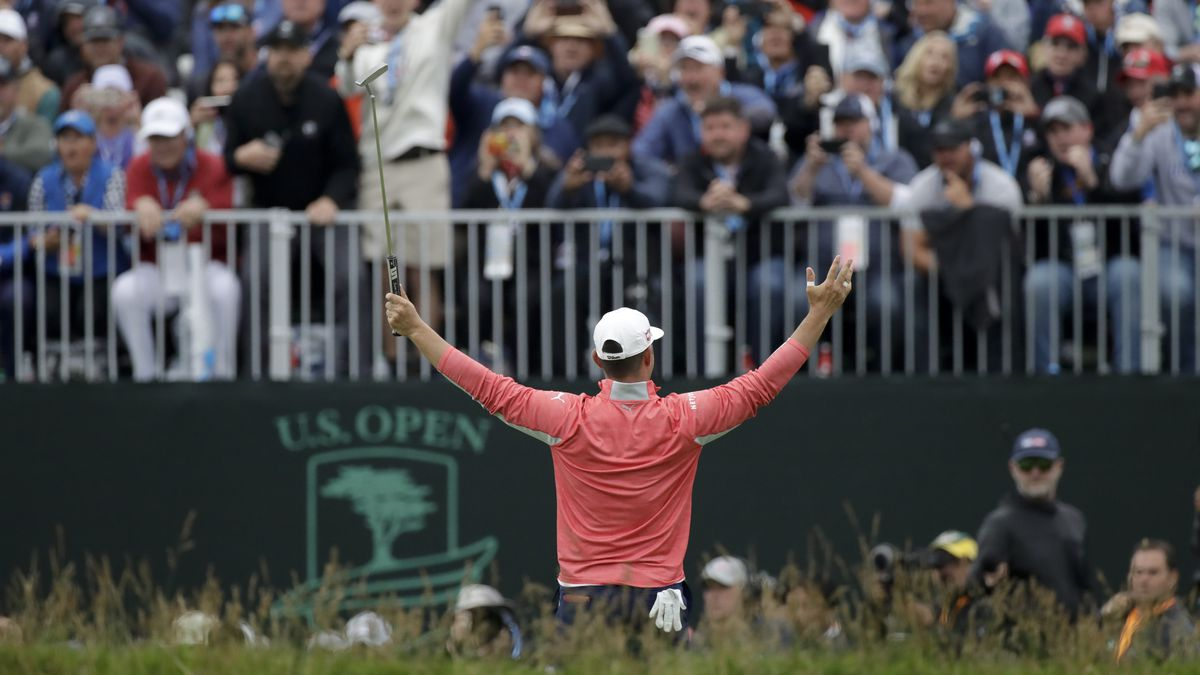 In this June 16, 2019, file photo, Gary Woodland celebrates in front of fans after winning the...