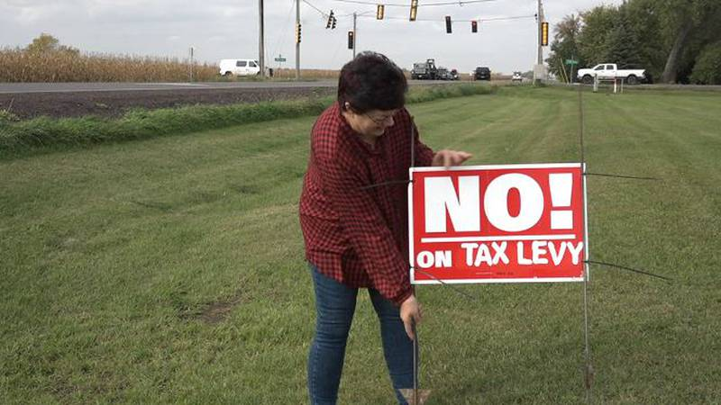 """Lincoln County residents vote """"no"""" on tax levy to build roundabouts. Betty Otten holds a sign..."""