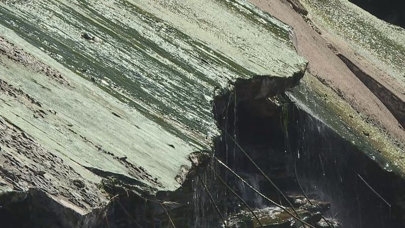Sections of concrete on the Elm Lake spillway have buckled and cracked after heavy rainfall...