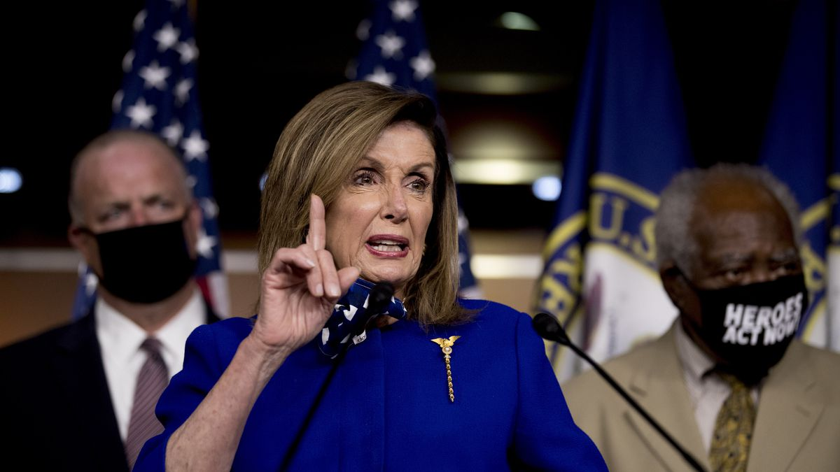 House Speaker Nancy Pelosi of Calif., accompanied by Rep. Dan Kildee, D-Mich., left, and Rep. Danny Davis, D-Ill., right, speaks at a news conference on Capitol Hill in Washington, Friday, July 24, 2020, on the extension of federal unemployment benefits.