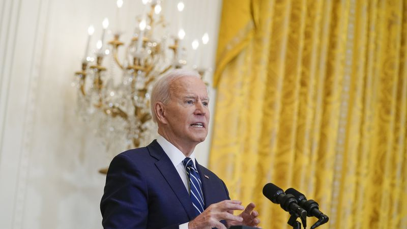 President Joe Biden speaks during a news conference in the East Room of the White House,...