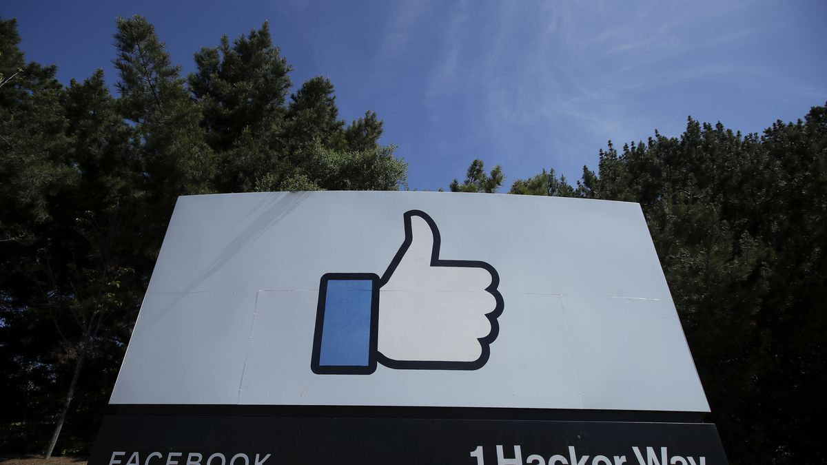 """The thumbs up Like logo is shown on a sign at Facebook headquarters in Menlo Park, Calif., Tuesday, April 14, 2020. Facebook has deleted a post by President Donald Trump for the first time, saying it violated its policy against spreading misinformation about the coronavirus. The post in question featured a link to a Fox News video in which Trump says children are """"virtually immune"""" to the virus. Facebook said Wednesday, Aug. 5, 2020 that the """"video includes false claims that a group of people is immune from COVID-19 which is a violation of our policies around harmful COVID misinformation."""""""