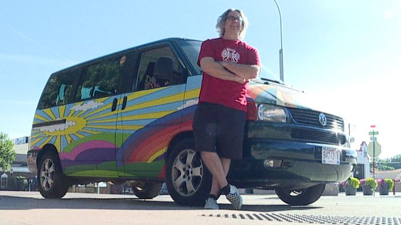 Jason Schlechter stands beside the VW van he uses to give tours of breweries in Sioux Falls.