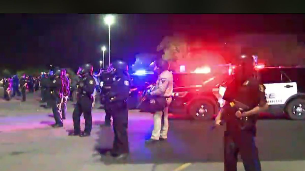 Police line attempts to disperse crowd at Empire Mall