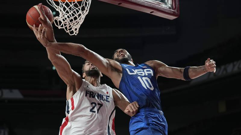 This photo shows the United States' Jayson Tatum (10) and France's Rudy Gobert (27) during a...