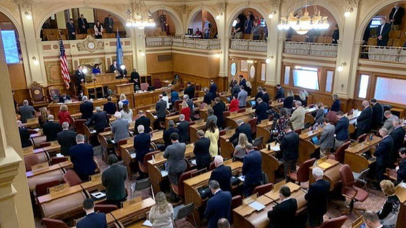 State lawmakers observe a moment of silence at the start of Dec. 8th joint session for Gov....