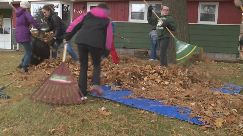 Volunteers rake leaves for those who can't