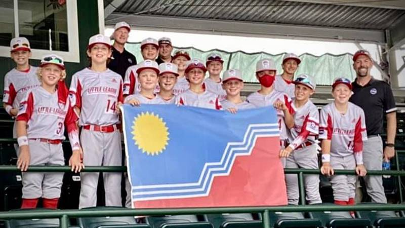Sioux Falls Little League team displays the Sioux Falls flag at the Little League World Series...